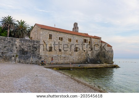 Old fortress in Budva. Fortress wall towering over the sea