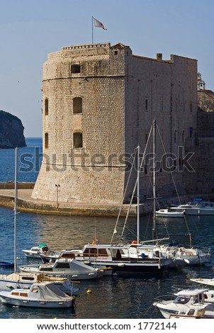 old fortress in Dubrovnik, Croatia, boats in the marine in foreground
