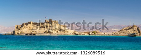 Old fortress of sultan Salah El Din in Taba - ancient landmarks of an arabic culture on Sinai Peninsula, Egypt. Panorama of medieval Citadel of Saladin on the Pharaoh's Island in the Gulf of Aqaba. Stock fotó ©