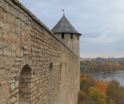 Old fortress tower. Towers and walls of an medieval castle fortress. Medieval fortress. Medieval castle. Wall and towers of medieval fortress
