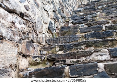 old fortress wall and staircase made from big stones masonry pattern background