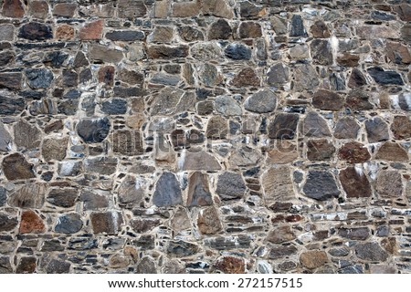 old fortress wall made from big stones masonry pattern background