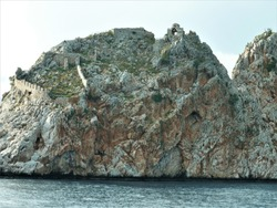 Old fortress with a church at Byzantine style, Alanya,Turkey. Ruins of Alanya castle at top of rock.
