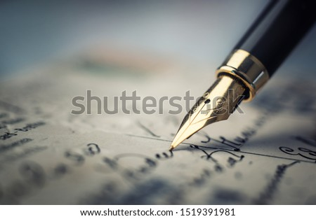 Old fountain pen on an vintage handwritten letter. Conceptual background on history, education, literature topics. Retro style. Сток-фото ©