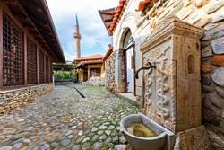 Old fountain with the minaret of Halveti's Tekke Mosque in the background, Prizren, Kosovo