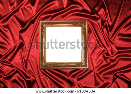 Old frame on luxury red satin