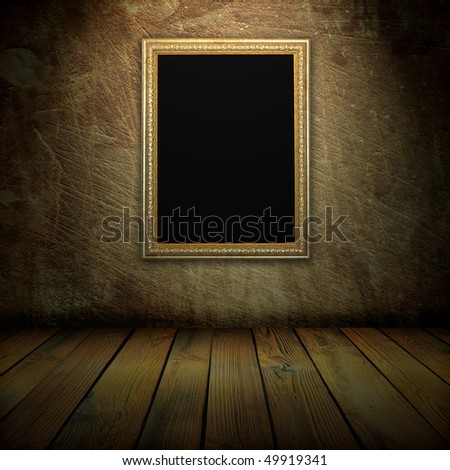 old frame on the wall in the interior grunge