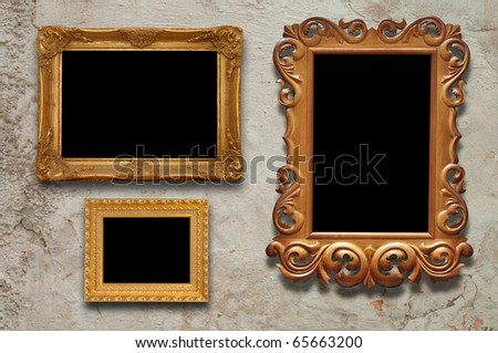 old frames on the wall in the interior grunge