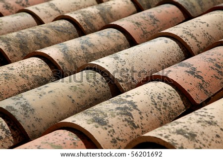 Old French terracotta roof tiles - stock photo