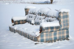 Old Furniture Left Outside in the Snow