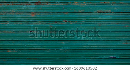 Old galvanized green steel wall rusty background texture