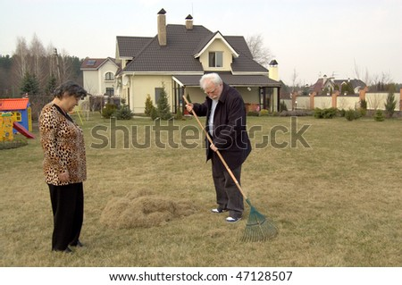 old gardener and woman on garden