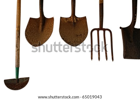 Old Gardening tools hanging on the wall isolated on white - stock photo