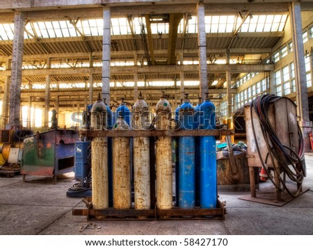 Old gas cylinders in an industrial warehouse...