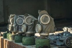 Old gas masks in abandoned building in Pripyat city in Chernobyl (Chornobyl) Exclusion Zone, Ukraine