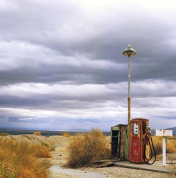 Old gas station in ghost town along the route 66 at border of the desert