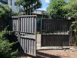 Old gate in a house, gray old gate