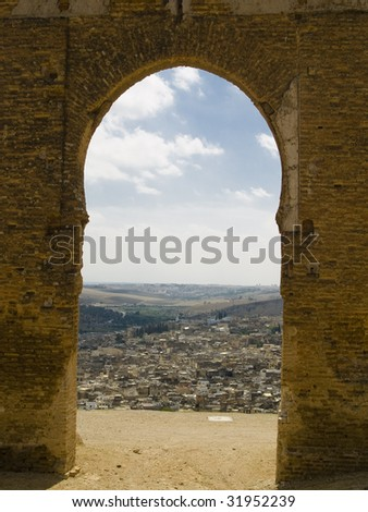 Old gate on the hill in backgroud Fes city, Morocco