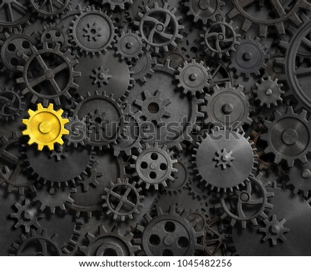 Old gears and cogs with gold one 3d illustration