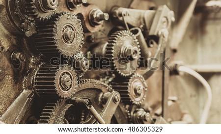 Old gears in black oil