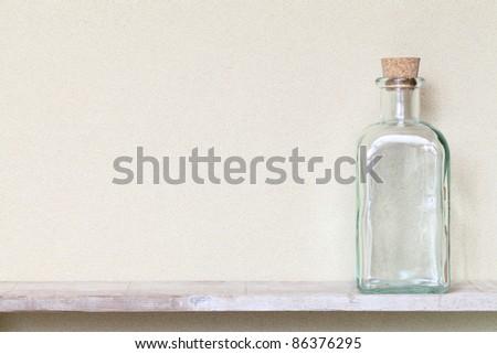 Old glass bottle on a shelf
