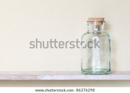 Old glass bottle on a shelf