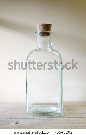 Old glass bottle on wooden shelf