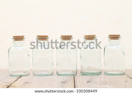 Old glass bottle on wooden table