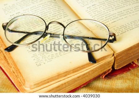 Old glasses over a vintage book of law