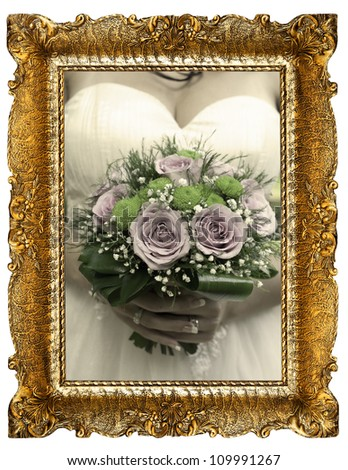 old gold frame and wedding bouquet