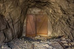 Old gold mine underground tunnel with closed doors