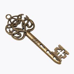 old gold skeleton key isolated on white background