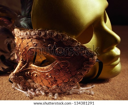 old gold venetian masks on a textile
