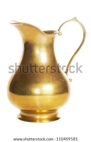 Old golden brass carafe over a white background
