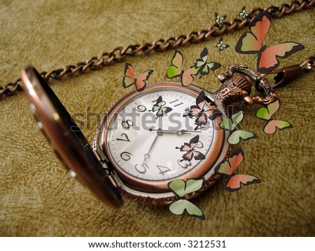 old golden clock on vintage background with many green butterflies