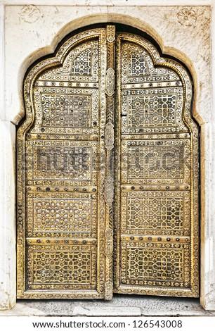 Old Golden Doors of the Hawa Mahal. Hawa Mahal, the Palace of Winds in Jaipur, Rajasthan, India.
