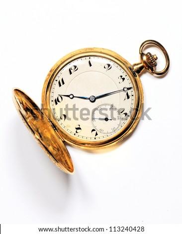 Old golden pocket watch on white background