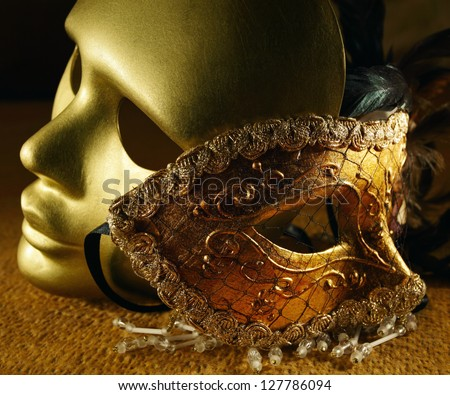 Old golden Venetian masks , focus on a center