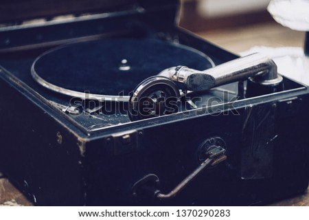 Old gramophone and record #1370290283