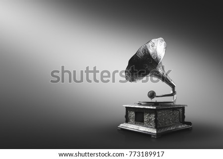 Old gramophone on a gray background #773189917