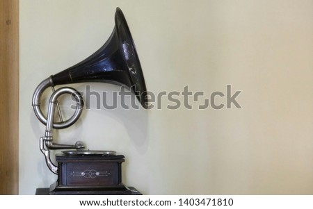old gramophone on wall background #1403471810