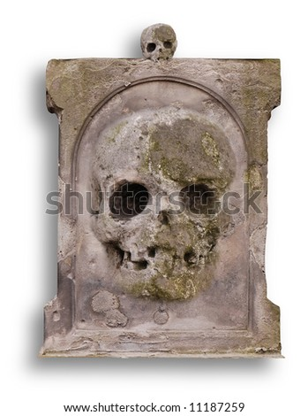 Old gravestone with a stone skull