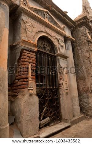 Old graveyard door with worn bricks