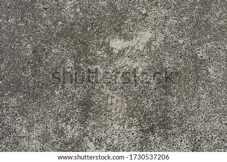 Old gray asphalt covered with sand . Sand on the asphalt Stock fotó ©