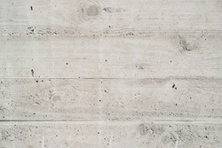 Old gray concrete wall. Concrete texture, closeup. Background texture of modern gray concrete wall. Wall made of blocks. Texture of plastered columns. Fair faced concrete seamless texture.