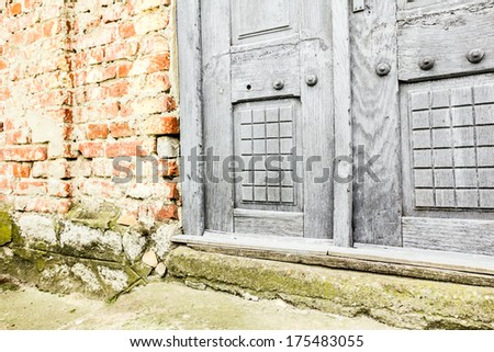 Old gray decorated door in low view