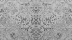 Old gray vintage shabby patchwork motif tiles stone concrete cement wall texture background