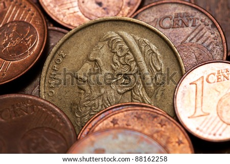 Old Greek coin among euro coins, drachmas (with the face of Homer, the ancient Greek  poet)