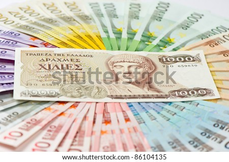 old greek drachma and euro cash notes. euro crisis concept