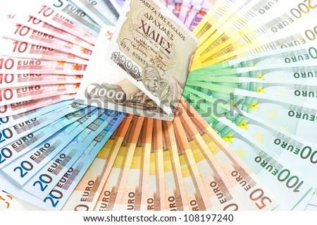 old greek drachma and euro cash notes. euro crisis concept. selective focus